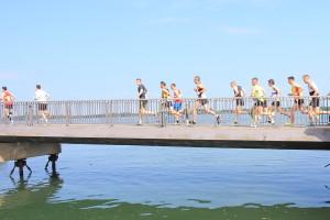 Jullian sets off at the start of leg 1.  210 miles of running lie ahead of us