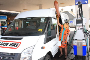 Fred Flintstone filling up the minibus